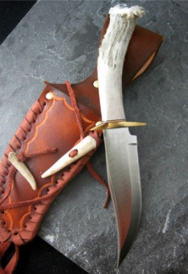 This knife is a one of a kind nature of the highest quality materials available. This knife was designed for the use of hunting and outdoor life, or as a collector's item. Each knife is made with 1085-High Carbon Tempered Spring Steel. All handles are chiseled by hand.  