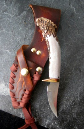 This knife is a one of a kind nature of the highest quality materials available. This knife was designed for the use of hunting and outdoor life, or as a collector's item. Each knife is made with 1085-High Carbon Tempered Spring Steel. All handles are chiseled by hand.   Small Size.