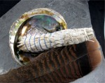 Each Smudging kit comes with the following; - 1 medium bundle of sage; - 1 abalone shell; - 1 large brown Turkey tail feather.