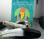"""Each Smudging Kit Comes With the Following; - 1 Medium Bundle of Sage; - 1 Abalone Shell; - 1 Imitation Eagle Feather; - 1 Copy of """"The Smudging and Blessings Book,"""" by Jane Alexander."""