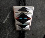 """Ebony, Coral, Turquoise, and Mother of Pearl.  Sterling Silver.  Artist: C. Dishta.  About 2"""" Long."""