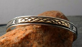 Navajo Hand Hammered Sterling Silver Bracelet with 14 Karat Gold Accents.