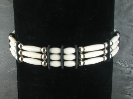 White bone and nickel beads on a waxed nylon cord. Sioux handmade by the Yellowhorse family from Pine Ridge.