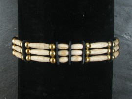 Antiqued white bone and brass beads on a waxed nylon cord. Sioux handmade by the Yellowhorse family from Pine Ridge.