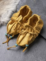 "Doeskin (deerskin) Baby Mocassins, extremely soft and adorable. Each tie strap is accentuated by a colored glass bead (varies among blue, green, red, black) and available in 2 sizes. 'Small' has about a 3"" long sole, 'large' has about a 4"" long sole. Please specify which you'd prefer. Handmade of the highest quality doeskin by a Western Shoshone Tribal member."